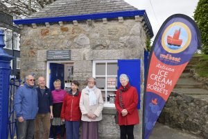 Red Boat owners Tony & Lyn Green (in doorway) with members of Menai Heritage and the Menai Bridge Civic Society